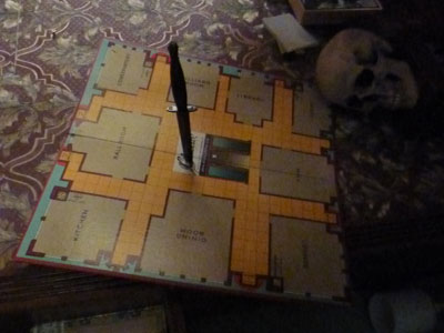 Picture of a Cluedo board with a knife through it